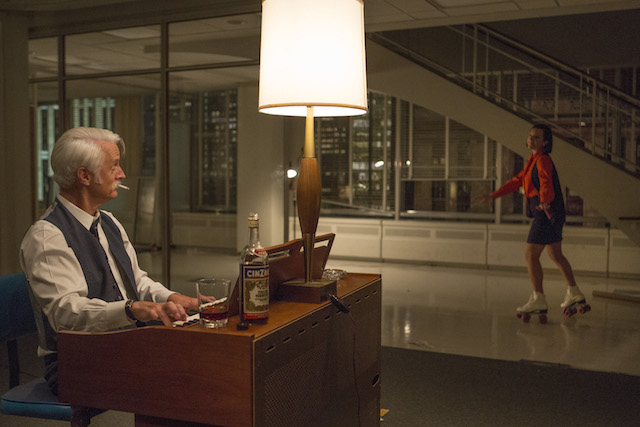 John Slattery as Roger Sterling and Elisabeth Moss as Peggy Olson - Mad Men _ Season 7B, Episode 12 - Photo Credit: Justina Mintz/AMC
